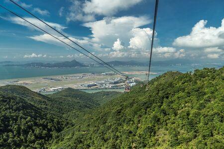 Cable car carries tourists up to the Ngong Ping Village in Lantau, Hong Kong, China.