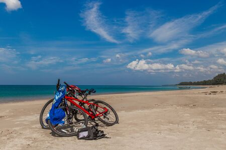 Two bicycles on Karon beach at summer day in Phuket, Thailand. July 2018