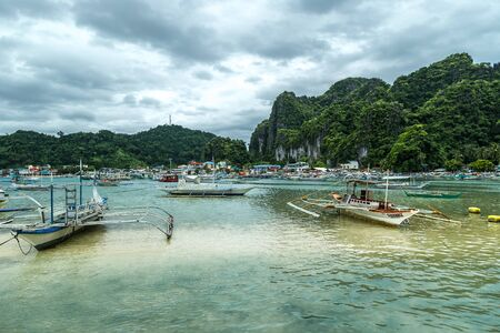 Traditional Boats and a Pier in El Nido, Palawan, Philippines