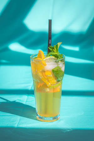 Glass of cold lemon ice tea Drink isolated on abstract blue background. Archivio Fotografico