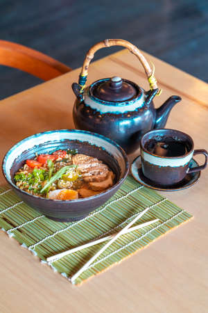 Green tea in teapot and Japanese Ramen.