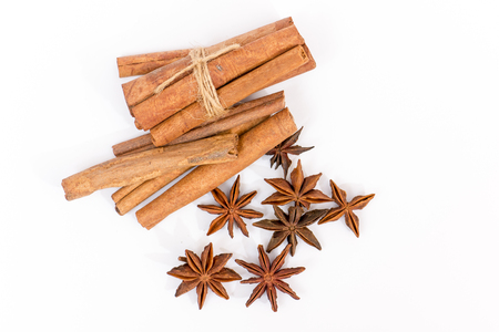 Anise and cinnamon isolated on white