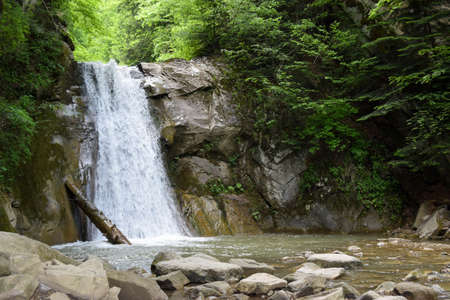 The landscape of Pruncea waterfall and the Casoca river in the Buzau mountains, Romania. A beautiful cascade in the forest