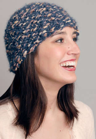 Smiling woman wearing a knit wool cap Stock Photo - 8561338