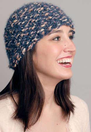 Smiling woman wearing a knit wool cap Stock Photo - 8561338