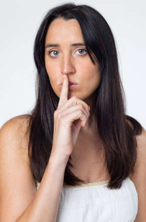 Woman with finger on lips Stock Photo - 8599529