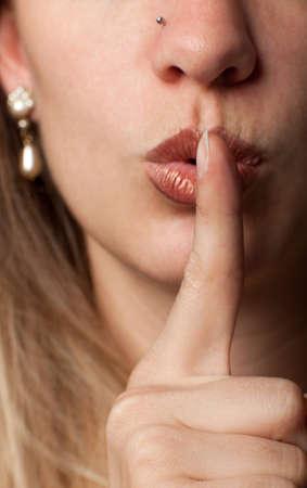 shushing: Woman making shushing gesture Stock Photo