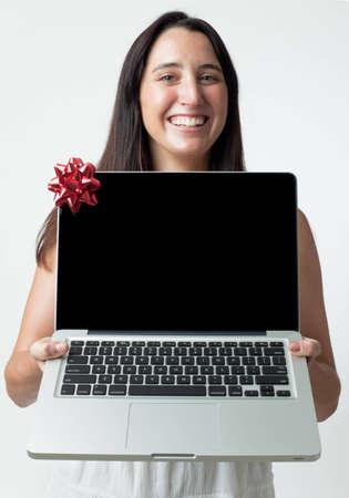 woman giving a laptop as a gift (no logos or brand names) Stock Photo - 8628365