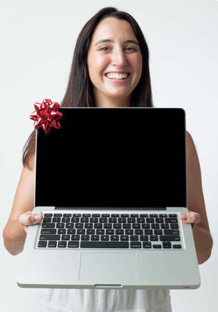 woman giving a laptop as a gift (no logos or brand names) Stock Photo - 8628365