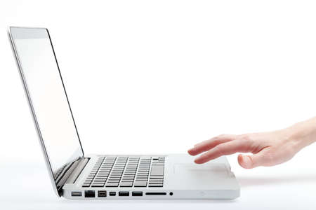 womans hand using trackpad on laptop computer (no logos or brand names)
