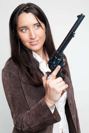 Cowgirl with a large revolver Stock Photo - 8628377