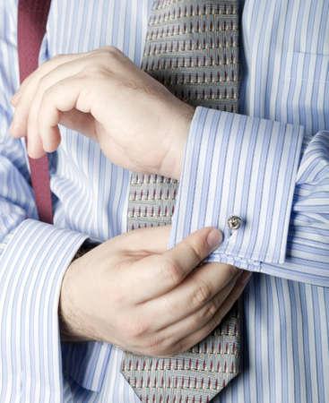 Businessman adjusting cufflinks