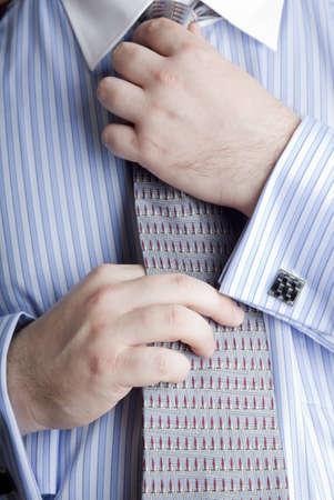 executive man straightening his necktie Banco de Imagens