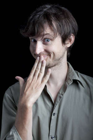 man acting titillated by gossip Stock Photo - 9107723
