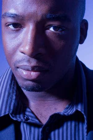 Black man in blue light