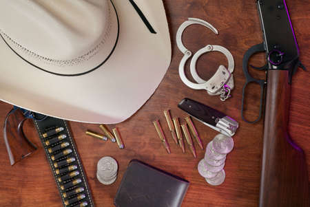 An assortment of the equipment carried daily by law enforcement officers in the American West. Stock Photo - 9788458
