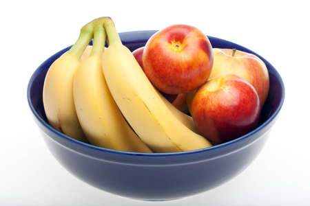 Bowl of fruit with apples, bananas and nectarine Stock Photo