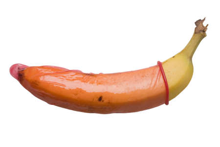 red condom: Banan in a red condom, isolated on a pure white background