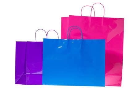 Three colorful gift or shopping bags isolated on a pure white background.