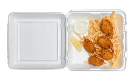 Five fried shrimp, some french fries, a lemon wedge and tartar sauce in an open takeout box from a fast food restaurant. Isolated on a pure white background. Photographed from directly above.
