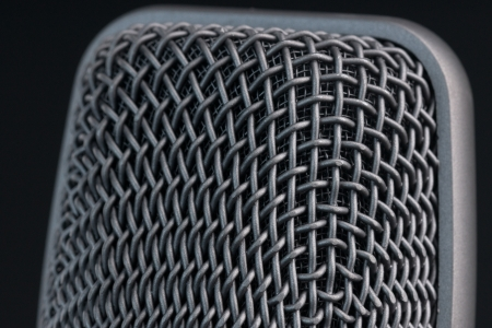 Closeup of the woven metal windscreen on a microphone head