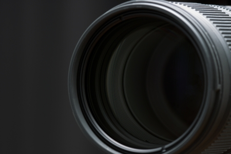 Closeup of the front glass element on a telephoto lens.