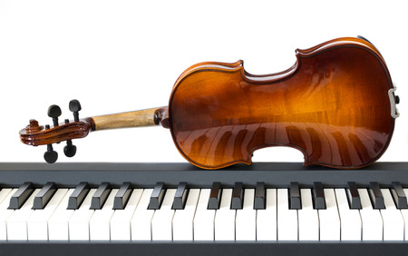 Piano keys and violin on a white background Stock Photo