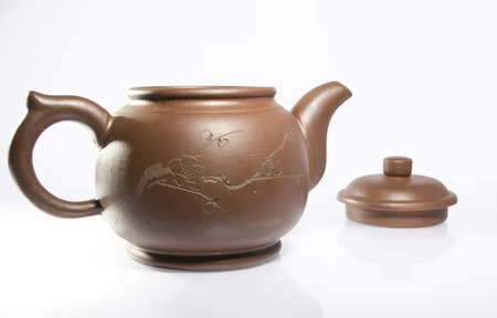 Clay teapot isolated on a white background Stock Photo