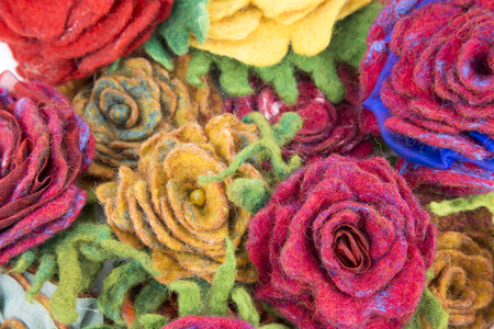 Brooch of fulled wool in the form of flowers closeup Stock Photo