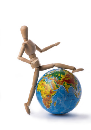 sitter: Figurine of a man steps over the globe