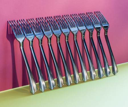 Abstract still-life with forks on a colorful background