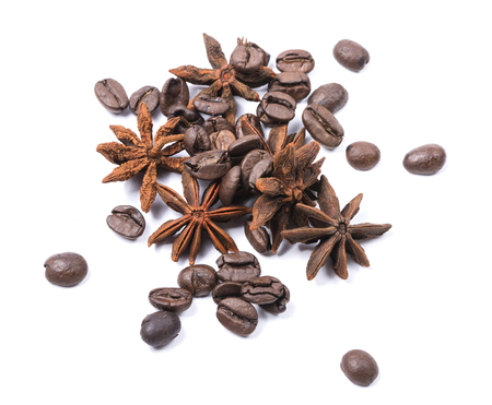 Fruits of anise and coffee beans on a white background