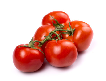 nightshade: Red ripe tomatoes on a white background Stock Photo