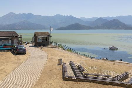 Household buildings on the shore of Lake Skadar, Montenegro. Stock Photo