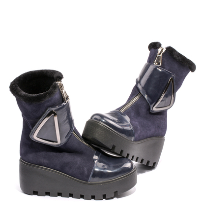 Female winter boots on high soles on a white background