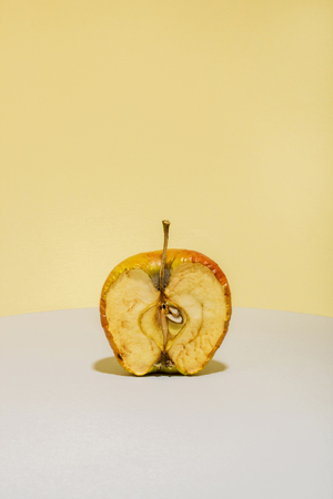 Old apple in a cut on a colored background Imagens - 90691646