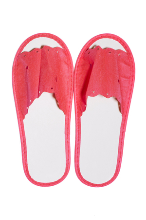 Red disposable hotel slippers on a white background Stock Photo