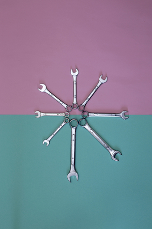 Figure of eight spanners on a colored background, top view