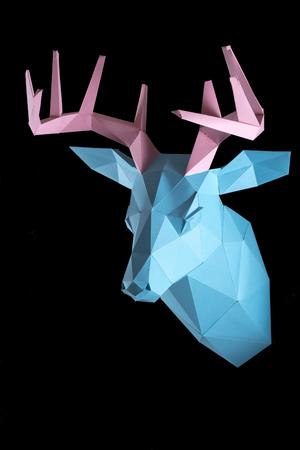 Papercraft, a piece of paper, a deer head with horns Reklamní fotografie