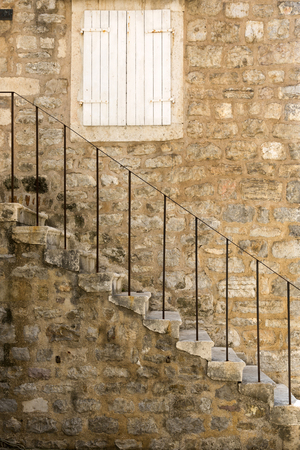 Fragment of an ancient building with a staircase in the old town of Budva, Montenegro