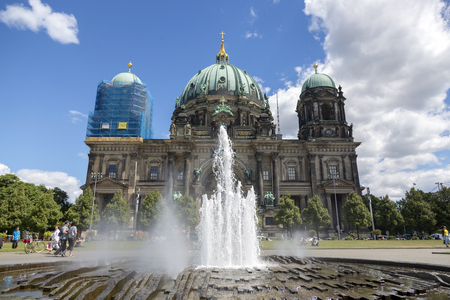 Berlin, Germany - July 01, 2018: Fountain in the center of the Lustgarten park in the background of the Berlin cathedral