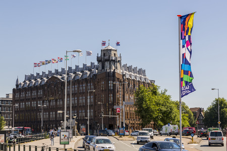 Amsterdam, Netherlands - July 02, 2018: Former building of the Dutch shipping company, now a grand hotel.