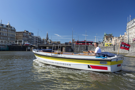 Amsterdam, Netherlands - July 02, 2018: Tourist on a pleasure motor boat in Amsterdam Editoriali