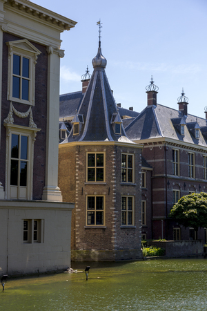 The Hague, Netherlands - July 03, 2018: Fragment of buildings Binnenhof with part of the palace pond