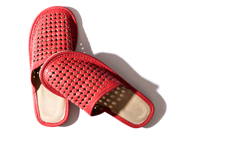 Red women's slippers on a white background