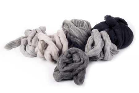 Hanks merino wool gray shades of color on a white background Reklamní fotografie