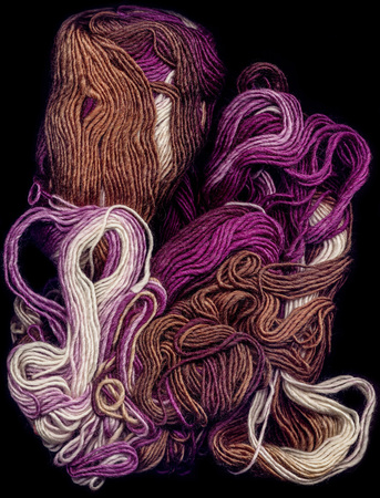 Multi-colored Wool natural threads on a black background