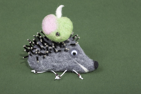Felted wool brooch in the shape of a hedgehog Archivio Fotografico