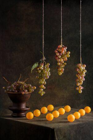 Still life with grapes and orange balls Banco de Imagens