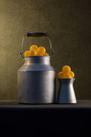 Still life with aluminum objects and orange balls